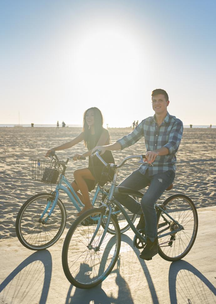 a couple biking on the beach