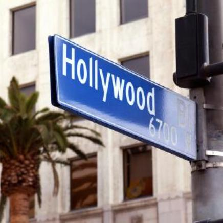 A blue and white Hollywood street sign